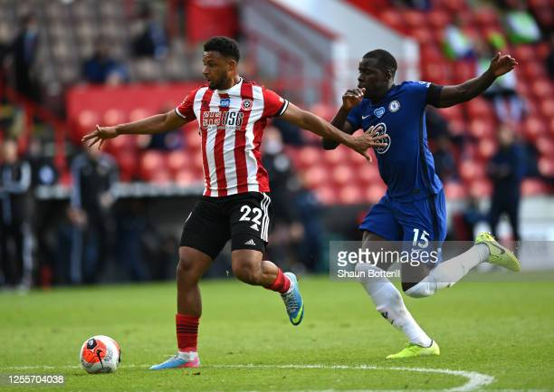 Lys Mousset of Sheffield United is challenged by Kurt Zouma of Chelsea during the Premier League match between Sheffield United and Chelsea FC at...