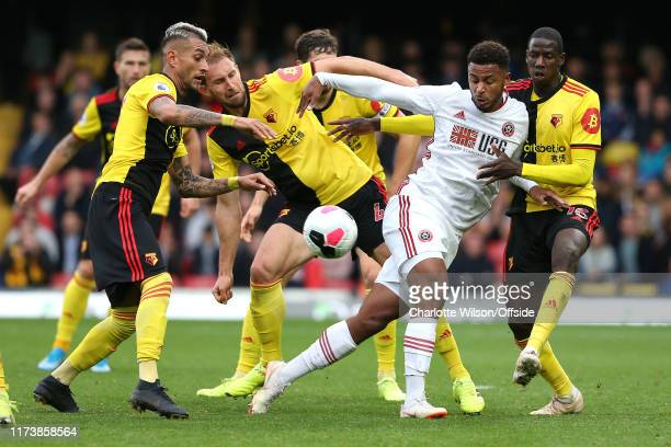 Lys Mousset of Sheffield United is surrounded by Watford players in the final seconds of injury time during the Premier League match between Watford...