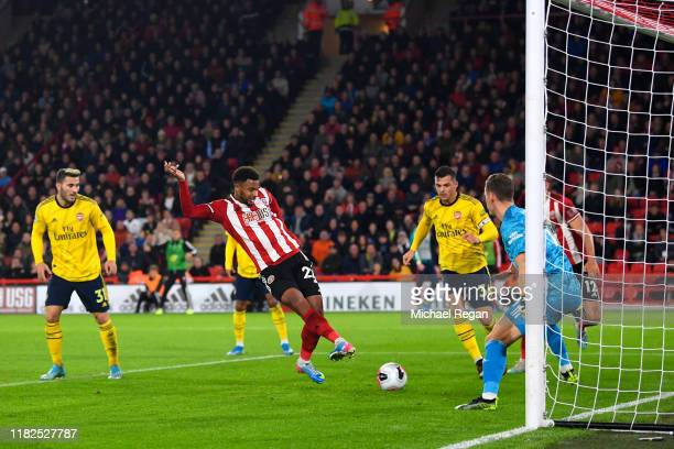 Lys Mousset of Sheffield United scores the winning goal during the Premier League match between Sheffield United and Arsenal FC at Bramall Lane on...