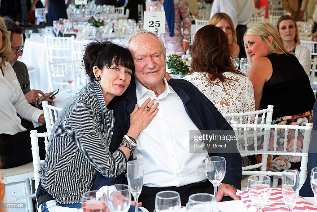 Lysette Anthony (L) and Julian Glover attend the Flannels for Heroes charity cricket match and garden party hosted by menswear brand Dockers at Burtons Court on June 19, 2015 in London, England.