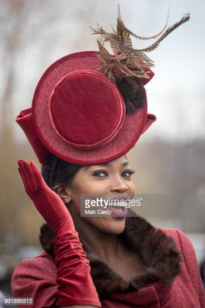 Lystra Adams poses for a photograph as she arrives for Ladies Day at Cheltenham Racecourse on March 14 2018 in Cheltenham England Thousands of racing...