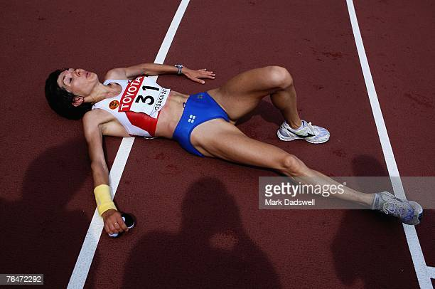 Lyubov Morgunova of Russia lays exhausted after crossing the finish line during the Women's Marathon on day nine of the 11th IAAF World Athletics...