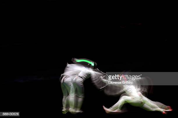 Lyubov Shutova of Russia competes against Simona Pop of Romania during a Women's Epee Team Semifinal bout on Day 6 of the 2016 Rio Olympics at...