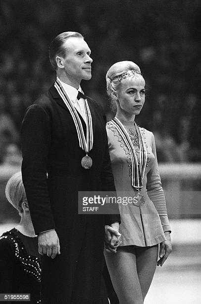 Lyudmila Belousova and her partner Oleg Protopopov from the Soviet Union stand of the podium of the figure skating pairs competition 15 february 1968...