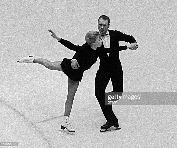 Lyudmila Belousova and her partner Oleg Protopopov from the Soviet Union execute their program during the figure skating pairs competition 29 January...