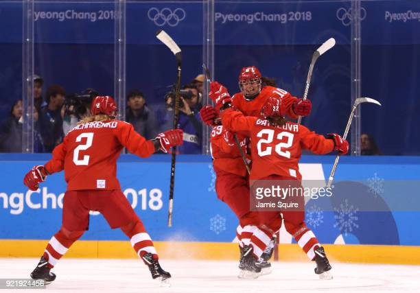 Lyudmila Belyakova of Olympic Athlete from Russia celebrates with teammates after scoring a goal in the third period against Finland during the...