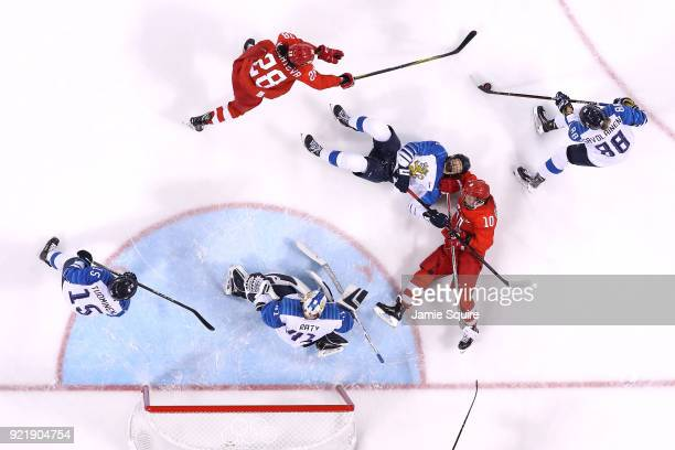Lyudmila Belyakova of Olympic Athlete from Russia competes with Tanja Niskanen of Finland as Ronja Savolainen attempts to clear the puck in the first...