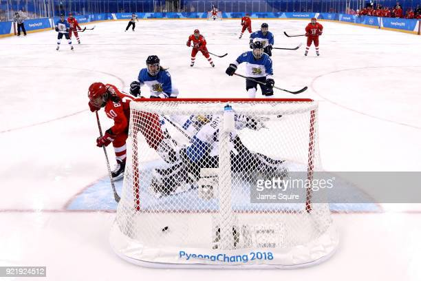 Lyudmila Belyakova of Olympic Athlete from Russia scores a goal against Noora Raty of Finland in the third period during the Women's Ice Hockey...