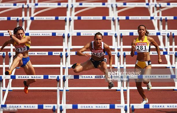 Lyudmila Blonska of the Ukraine Jessica Ennis of Great Britain and Lucimara da Silva of Brazil compete in the 100m Hurdles during the Women's...