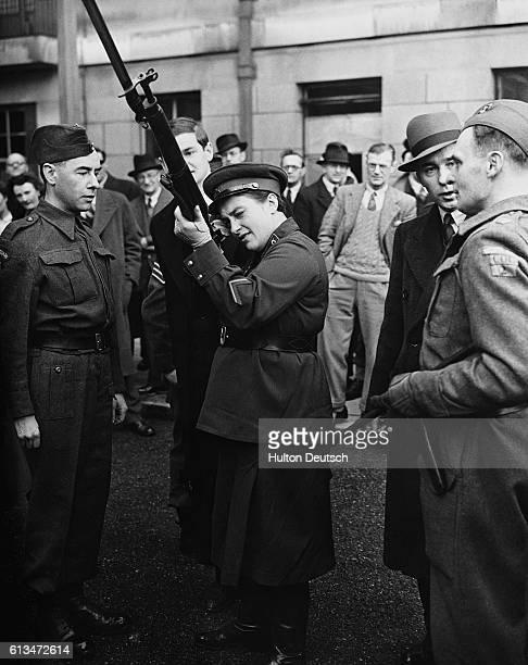 Lyudmilla Pavlichenko a twentysixyearold Soviet sniper tries out a rifle belonging to a member of the British Home Guard November 1942