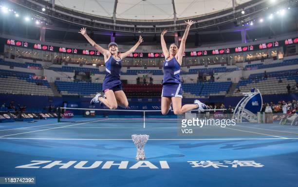 Lyudmyla Kichenok of the Ukraine and Andreja Klepac of Slovenia celebrate with the trophy after winning the Women's Doubles final match against Duan...