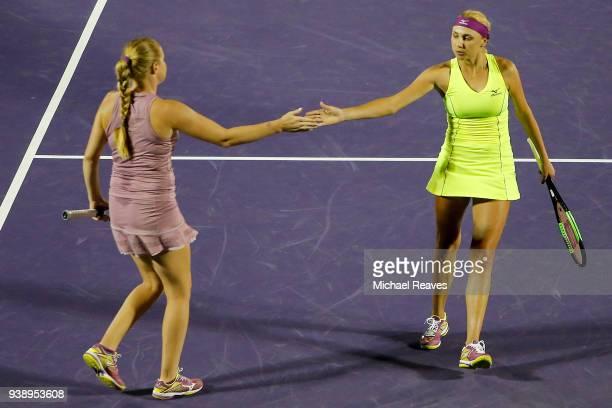 Lyudmyla Kichenok of Ukraine and Alla Kudryavtseva of Russia celebrate after a point against Ekaterina Makarova and Elena Vesnina of Russia during...
