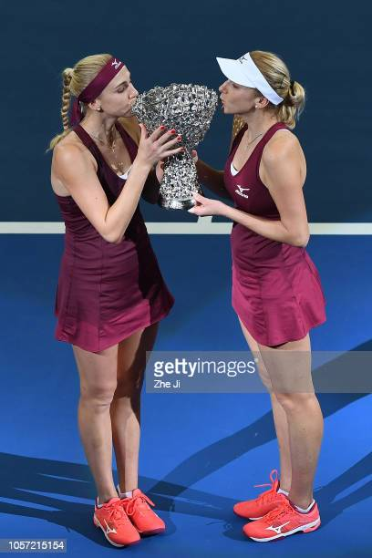 Lyudmyla Kichenok of Ukraine and Nadiia Kichenok of Ukraine celebrate with trophy during the Award Ceremony after winning the women's doubles final...