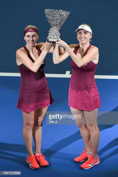 Lyudmyla Kichenok of Ukraine and Nadiia Kichenok of Ukraine celebrate with their trophy during the Award Ceremony after winning the women's doubles...