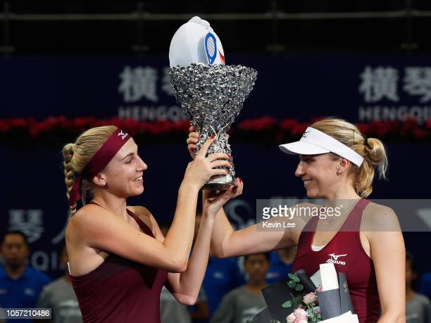 Lyudmyla Kichenok of Ukraine and Nadiia kichenok of Ukraine pose with their trophy after defeating Lidziya Marozava of Belarus and Shuko Aoyama of...