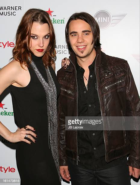 Lzzy Hale and Joe Hottinger attend the Warner Music Group 2013 Grammy Celebration Presented By Mini held at Chateau Marmont on February 10 2013 in...