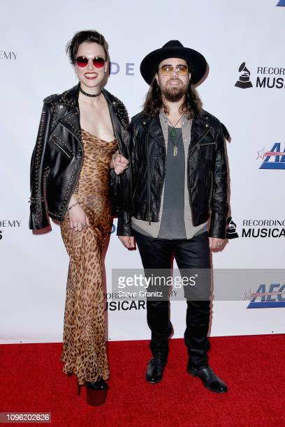 Lzzy Hale and Joe Hottinger of Halestorm attend MusiCares Person of the Year honoring Dolly Parton at Los Angeles Convention Center on February 8...