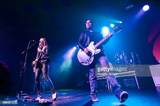 Lzzy Hale and Joe Hottinger of Halestorm perform on stage at Barrowlands Ballroom on March 6, 2015 in Glasgow, United Kingdom.