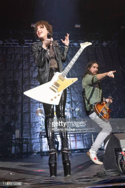 Lzzy Hale and Joe Hottinger of Halestorm perform on stage at The SSE Hydro on November 24, 2019 in Glasgow, Scotland.