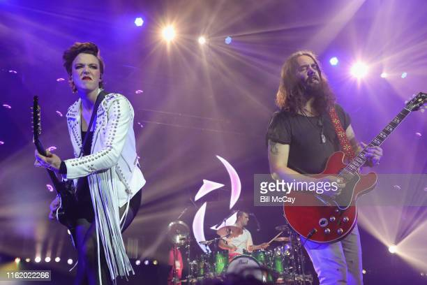 Lzzy Hale and Joe Hottinger of the band Halestorm perform at the BBT Pavilion August 16 2019 in Camden New Jersey