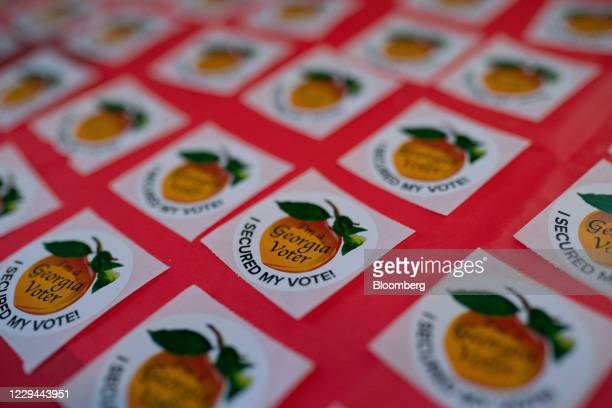 'I'm a Georgia Voter' stickers on a table at a polling location for the 2020 Presidential election in Atlanta Georgia US on Tuesday Nov 3 2020...