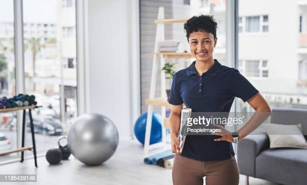 i'm a specialist at getting you back to full health - physical therapist stock pictures, royalty-free photos & images