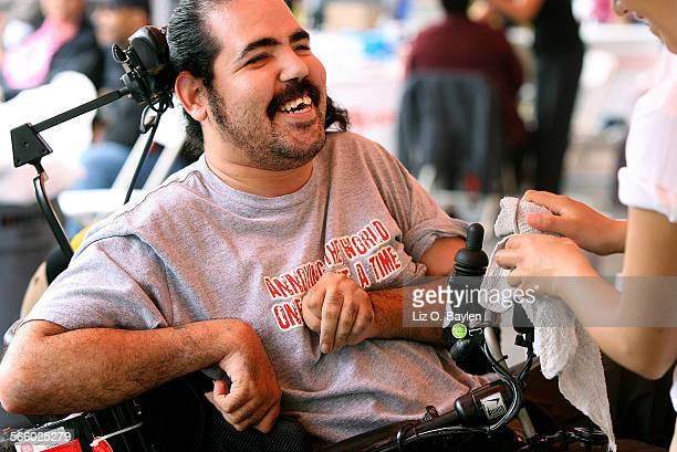 """M always going out; I'm never in the house so it gets dirty,"""" Luis Rivera says about his wheelchair. He was happy to get it washed at the Familia..."""