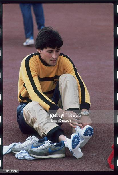 M. And 1500 m. Runner Sebastian Coe puts on his running shoes at the Heinz Games in Crystal Palace, London.