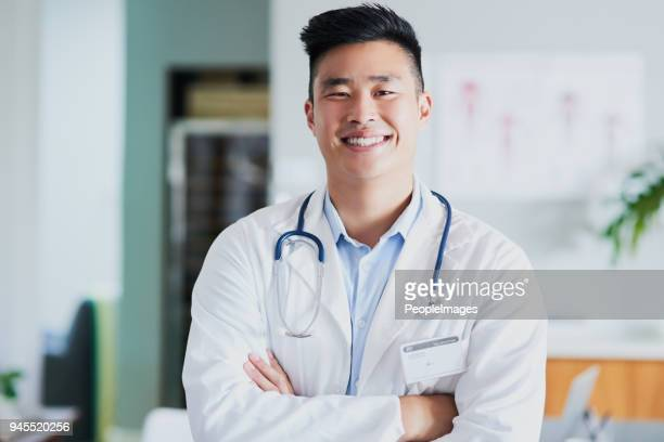 i'm confident i can care for you - male doctor stock photos and pictures
