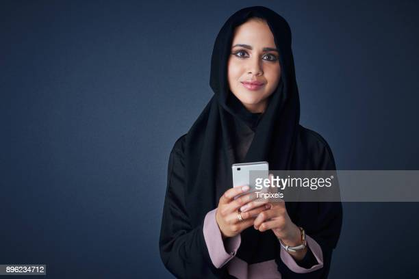 i'm connected, let's chat - muslim woman darkness stock photos and pictures