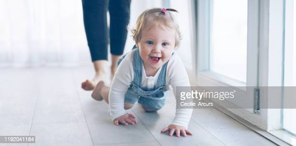 i'm getting there mommy! - baby m stock pictures, royalty-free photos & images