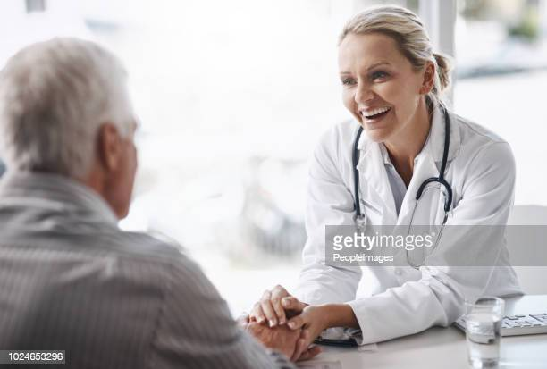 i'm glad to see you're in such great health - female doctor stock photos and pictures