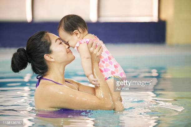 i'm glad we signed up for swimming class - baby m stock pictures, royalty-free photos & images
