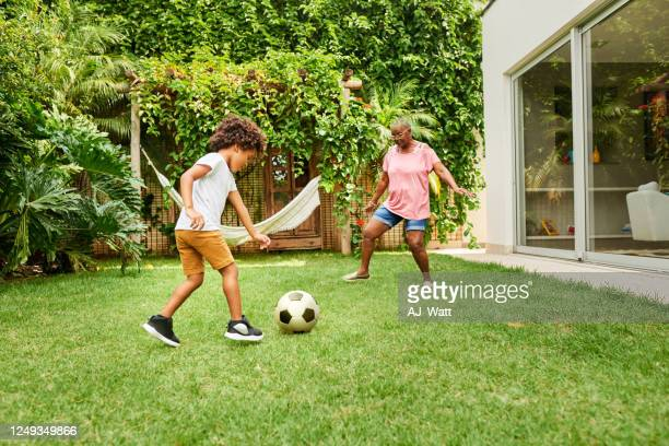 i'm going for goal grandma! - leisure games stock pictures, royalty-free photos & images