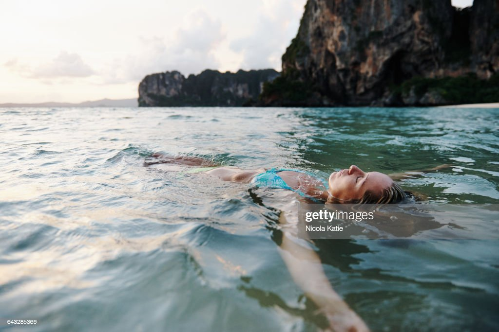 I'm happiest when floating in the sea : Stock Photo