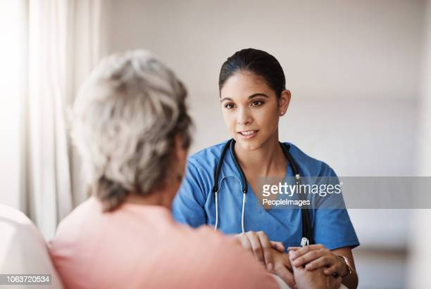 i'm here for you...always - female nurse stock pictures, royalty-free photos & images