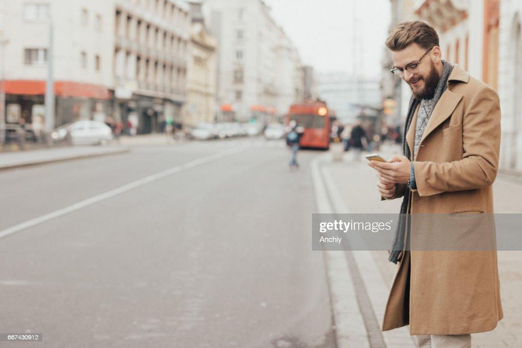 I'm late! Man waiting for uber : Stock Photo