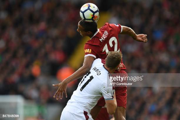m Liverpool's Germanborn Cameroonian defender Joel Matip wins a header from Burnley's New Zealand striker Chris Wood during the English Premier...