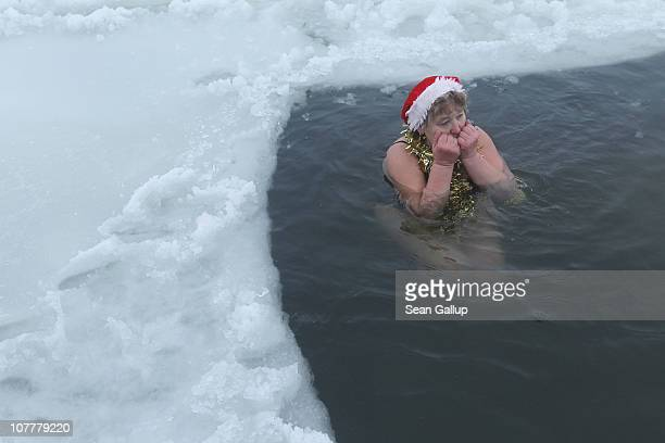 'I'm not cold' exclaims Marina Hunger a member of the Berlin Seals swimming club as she takes a dip in icy Orankesee lake during the club's...