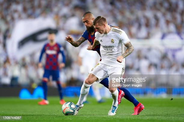 m of Real Madrid competes for the ball with Arturo Vidal of FC Barcelona during the Liga match between Real Madrid CF and FC Barcelona at Estadio...