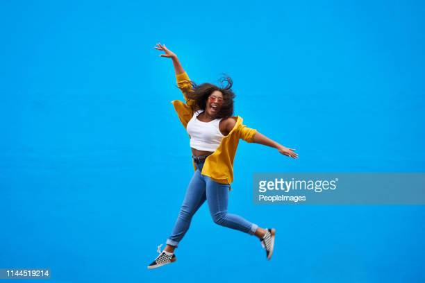 i'm on top of the world! - jumping stock pictures, royalty-free photos & images