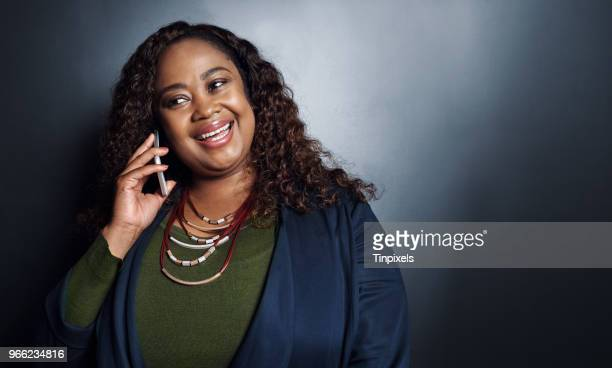 i'm so glad you called - curvy african women stock pictures, royalty-free photos & images