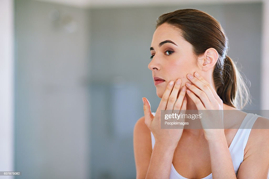 I'm sure this will go away if I pop it... : Stock Photo