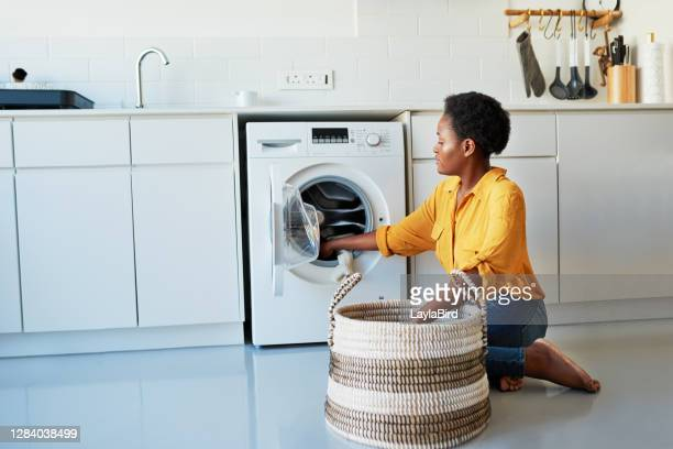 i'm tackling the laundry first - washing machine stock pictures, royalty-free photos & images