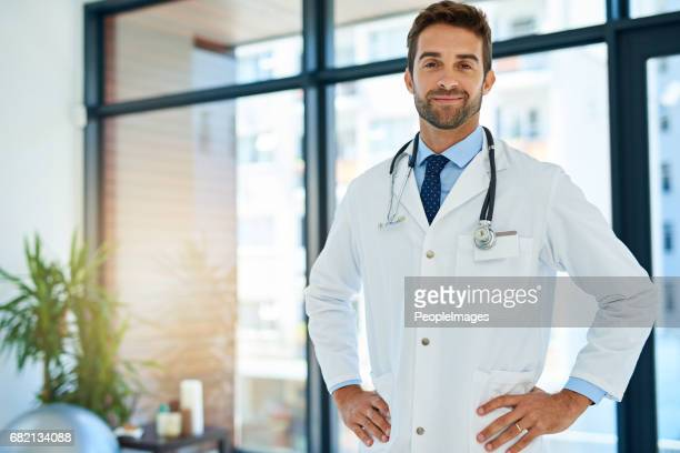 i'm the best at what i do - handsome doctors stock pictures, royalty-free photos & images