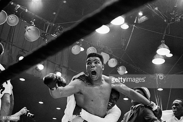"M the champ!"" screams Cassius Clay as his handlers hug him joyfully after he defeated Sonny Liston for the heavyweight boxing title. Clay was..."