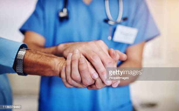 i'm with you every step of the way - male nurse stock pictures, royalty-free photos & images