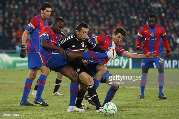 m11 Benjamin Huggel Jacques Zoua David Abraham and Cabral of Basel during the UEFA Champions League Round of 16 first leg match between FC Basel 1893...