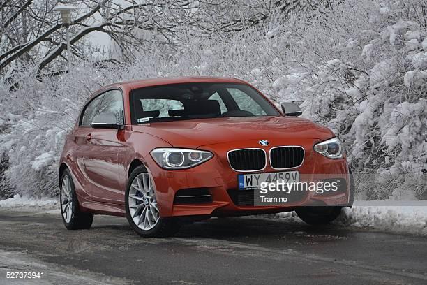 bmw m135i in winter scenery - bmw bildbanksfoton och bilder