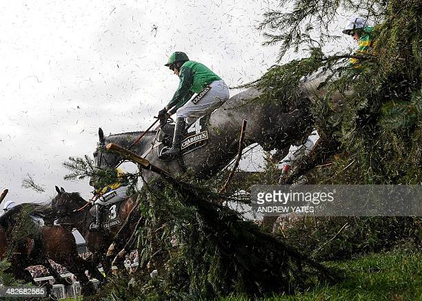 Ma Filleule ridden by Barry Geraghty clears the Chair on its way to winning the Topham Steeple Chase during Ladies Day during the Grand National...